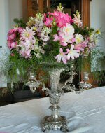 Flowers arranged in a silver vase.